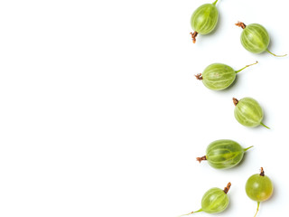 Heap of ripe green gooseberry berries on white background. Creative layout made of organic gooseberries. Isolated on white with clipping path. Top view or flat lay. Copy space for text. Food concept.