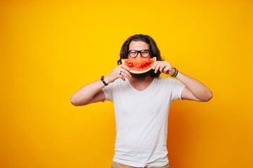 Man holding slice of watermelon