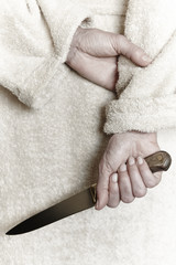 Killer woman with a knife. Violence aggression. Criminal murderer