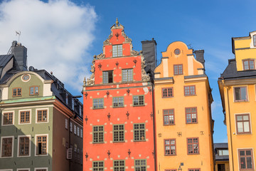 Colorful facade of the houses in Stortorget Square Gamla Stan. Stockholm, Sweden. Summer sunny day with blue sky.