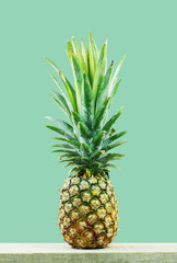 Pineapple with green background.