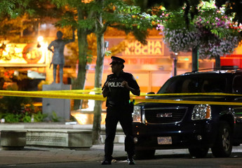 A police officer guards the scene of a mass shooting in Toronto