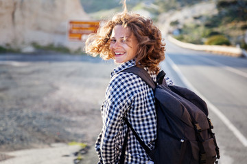 Young beautiful happy smiling woman, summer portrait, fluttering hair, summer adventures and travel