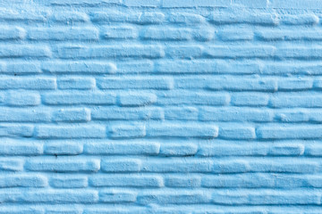 Horizontal blue brick wall background, facade of the house