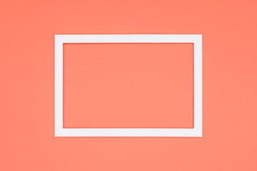 Abstract flat lay pastel orange colored paper texture minimalism background. Minimal template with empty picture frame mock up.