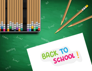 back to school. White sheet of paper with a sticker: Back to school. Pencil case with pencils on a school board