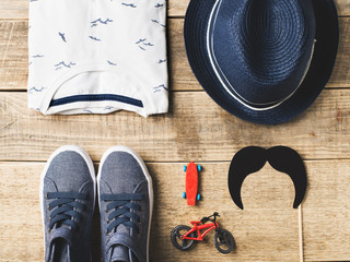 Kids hipster fashion flat lay with clothes and accessories
