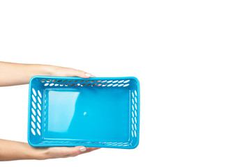 Blue laundry basket with hand, grocery container isolated on white background. copy space template