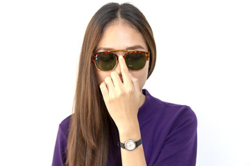 Fashion portrait of young woman wearing a sunglasses with white background.