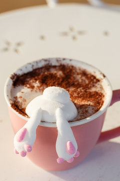 Cute bunny marshmallow in cup of coffee or cocoa. Funny food concept
