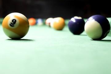 Billiards balls on a green board