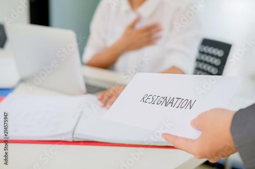 surprised confused caucasian employee receiving dismissal notice