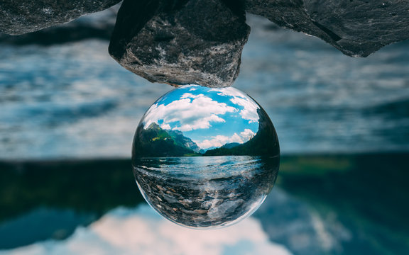 mountain scenery reflection in a glass ball, lensball. klontalersee in the alps