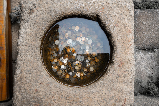 Small well with coins
