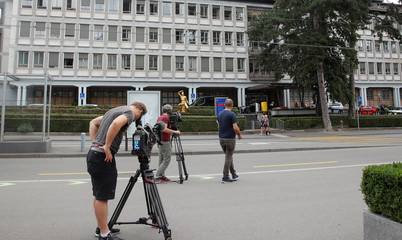 TV cameramen take pictures in front of the university hospital (Universitaetsspital) in Zurich