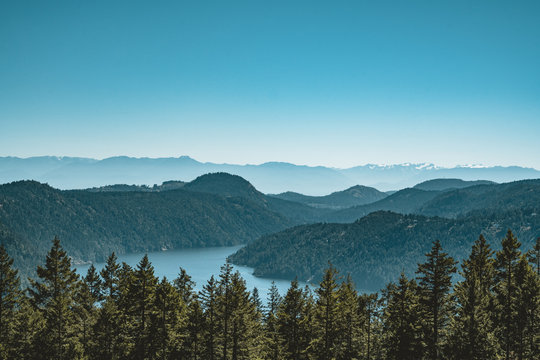 Vancouver Island view on a clear blue sky and pacific coast. Canada.