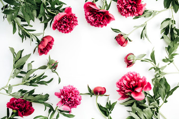 Frame of pink peony flowers on white background. Flat lay, top view mock up.