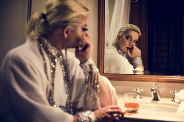 Russian drag queen alone in bedroom