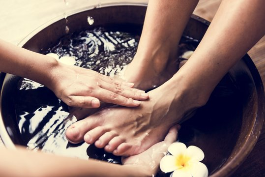 Closeup of feet cleaning at spa