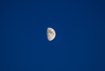 a Beautiful blue cloud,the Moon on clear sky.