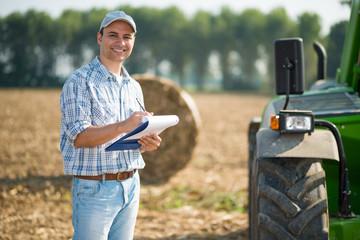 Farmer writing on a document