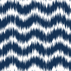 Ikat ornament. Tribal Waves pattern in Aztec style. Hand Drawn folklore seamless pattern
