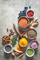 Various colorful superfoods in bowls