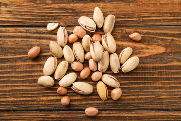 Pile of different nuts on wooden background