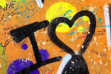 Detail of bright colorful wall with graffiti