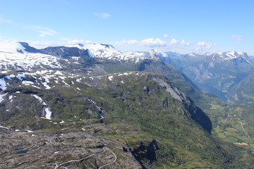 View of mountains and a road from Dalsnibba view point near Trollstigen and Geiranger, Norway