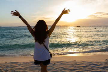 woman hand up feel relax on the beach on holiday