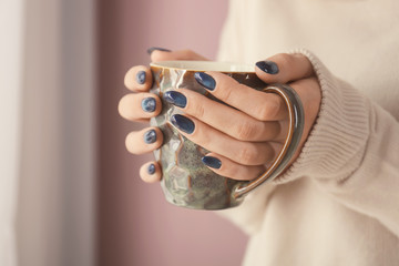 Poster de jardin Manicure Young woman with beautiful manicure holding cup of beverage, closeup