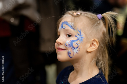 Cute Little Blond Girl With Face Painting Blue Abstract