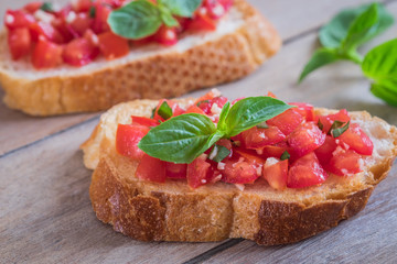 Bruschetta with chopped tomato and basil on toast