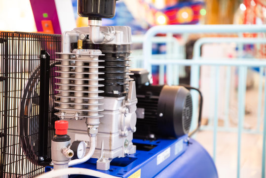 Close up air compressor engine machine. industrial engineering concept.