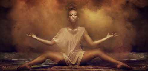 Beautiful afro girl dancer over dust.