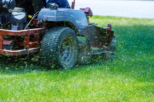 Red Lawn mower cutting grass. Gardening concept