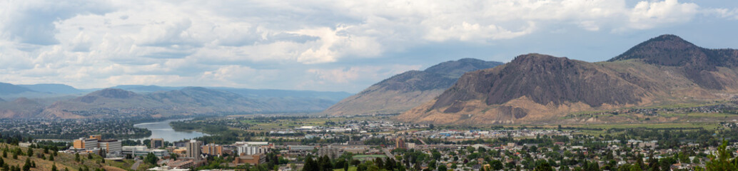 Aerial panoramic view of Kamloops City during a cloudy summer day. Located in Interior BC, Canada.