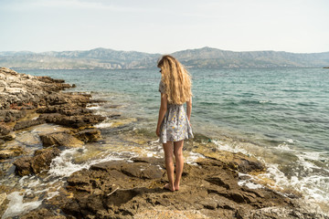 Girl at the adriatic on a sunny day