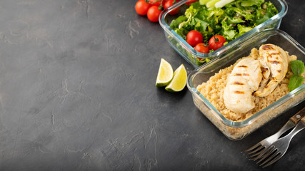 Healthy meal prep containers with quinoa, chicken breast and green salad overhead shot with copy space
