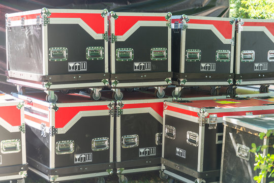 Lot of Lighting Cases on street concert
