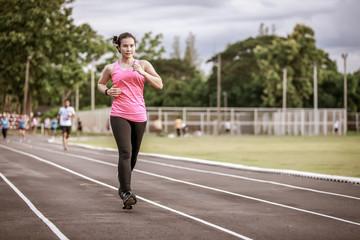 Woman asian Marathon running race, Run up the mountain road.