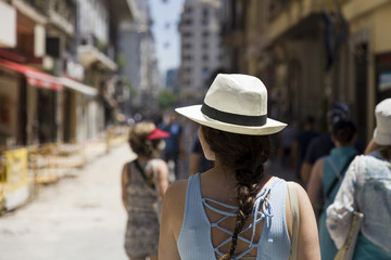 Pretty young woman with hat on the street of Buenos Aires