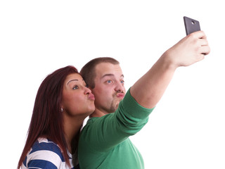 young people making silly duck face while taking a self portrait with smart phone