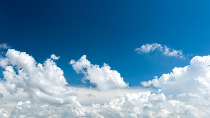 Wonderful white cumulus clouds on blue sky
