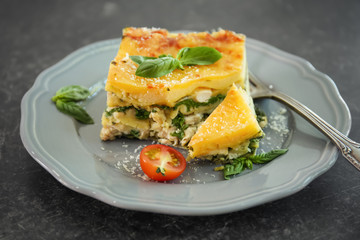 Lasagna with spinach on table