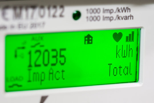 Smart meter digital display, showing units and focus on kilowatt hour symbols.
