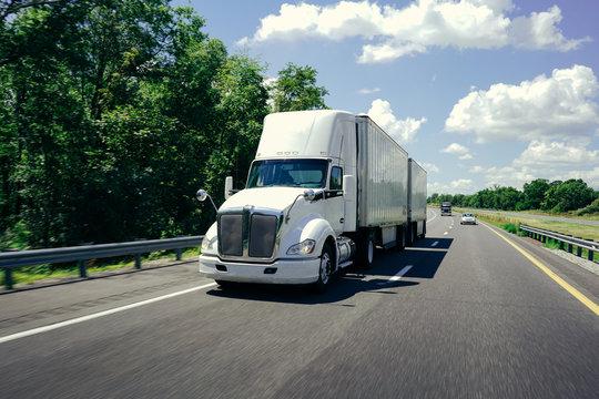 White 18 wheeler semi-truck double trailers