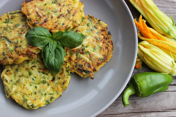 Pancakes from zucchini with parsley