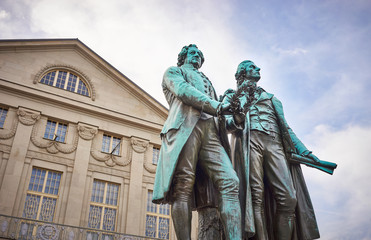 Famous sculpture of Goethe and Schiller in the city of Weimar in Germany / Most famous classical german authors / 18th century
